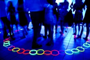 red yellow pink green blue assorted glow necklaces and bracelets at party