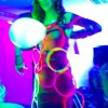 girl wearing glow necklaces and bracelets with balloons