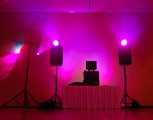 pink theme party lighting setup with dj