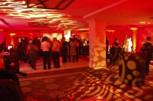red rockstar lounge with patterned lighting and people dancing
