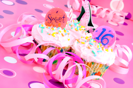 pink sweet sixteen cupcakes with pink frosting and sprinkles