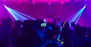 sweet sixteen glow party with club lighting and blacklights
