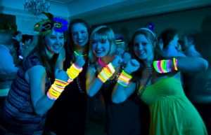 showing off glow bracelets at sweet 16 party