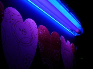 blacklight and neon hearts lit up