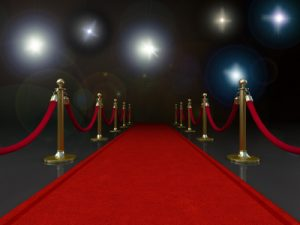 red carpet entrance stanchion camera flashes