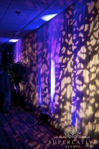 Pipe And Drape With Texture Lighting Purple Uplighting